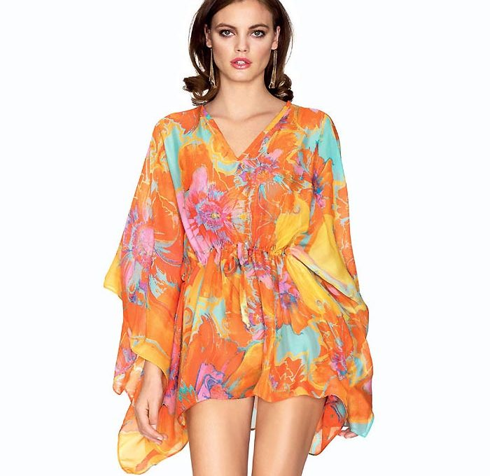 A beautifully elegant kaftan from Roidal in orange, purple and turquoise