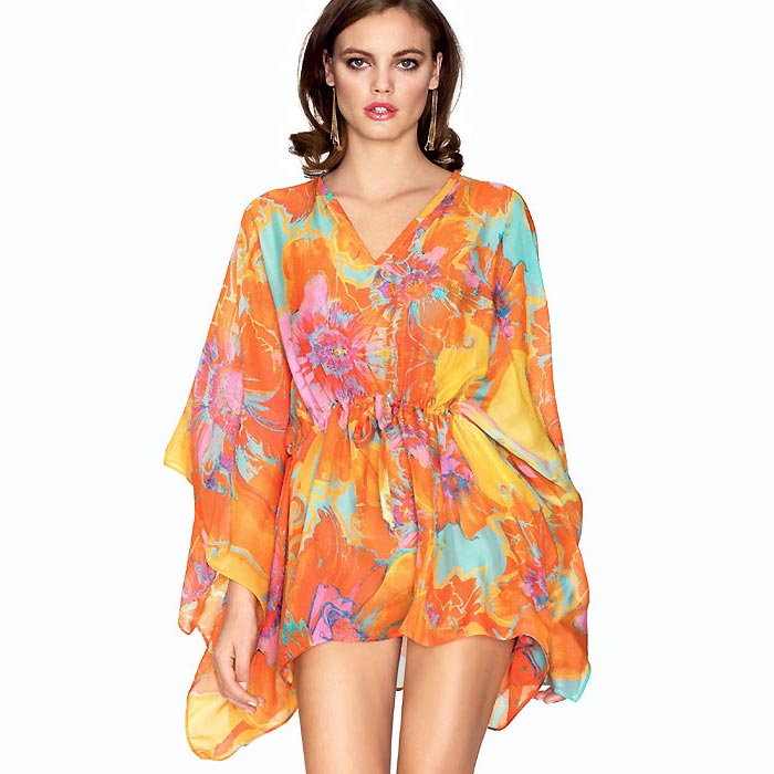 af5d99c6225 A beautifully elegant kaftan from Roidal in orange, purple and turquoise