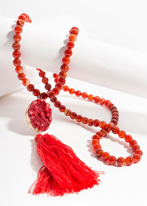 Red neckline with large tassel