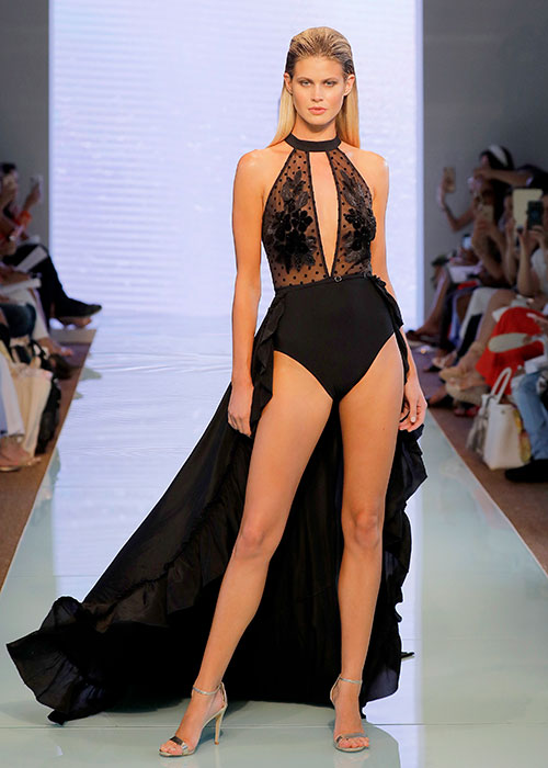 Luxury plunge swimsuit in black with maxi skirt. Gottex 2020 swimwear collection
